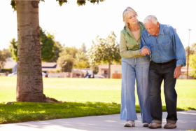 Caregiver assisting an elderly in walking