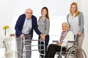 Elderlies on wheelchairs accompanied by their caregivers