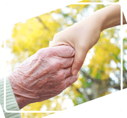 Hands of a senior and a caregiver