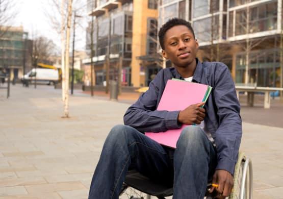 Boy holding folders