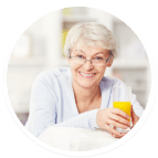 Female senior holding a glass of orange juice
